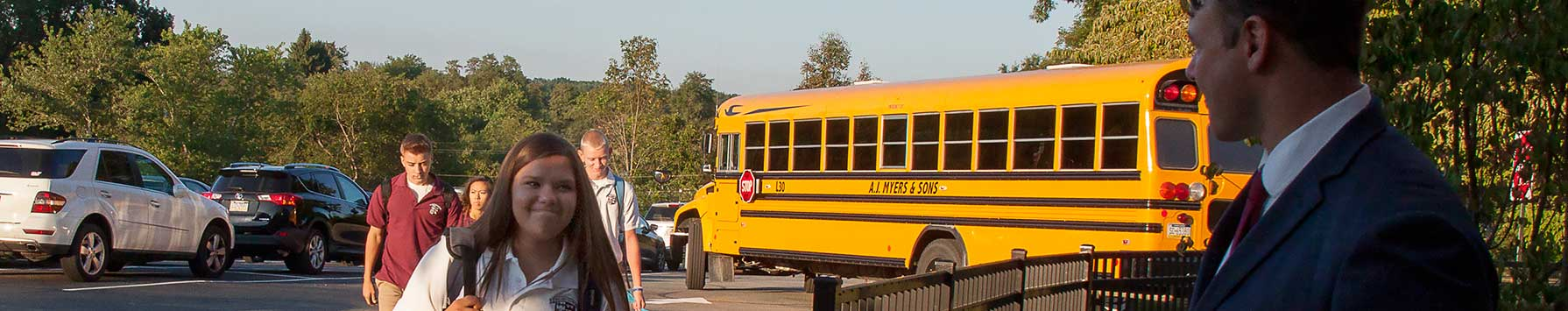 students getting off buses